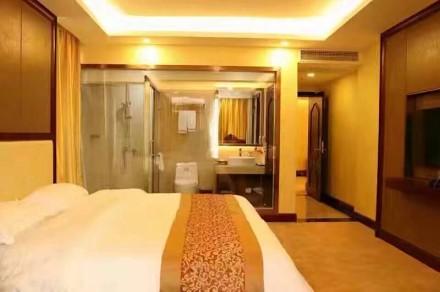 海丰怡冠酒店卧室