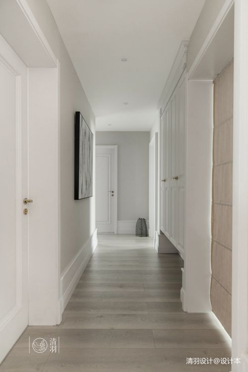 优美124平混搭三居过道实景图玄关木地板